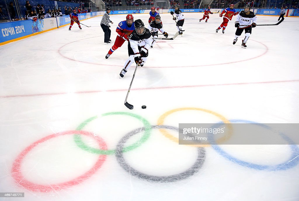 Kanae Aoki #5 of Japan handles the puck against Anna Shokhina #29 of Russia in the third period during the Women's Ice Hockey Classification game on day nine of the Sochi 2014 Winter Olympics at Shayba Arena on February 16, 2014 in Sochi, Russia.