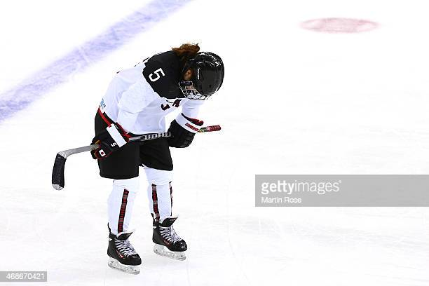 Kanae Aoki of Japan reacts against Russia during the Women's Ice Hockey Preliminary Round Group B game on day four of the Sochi 2014 Winter Olympics...