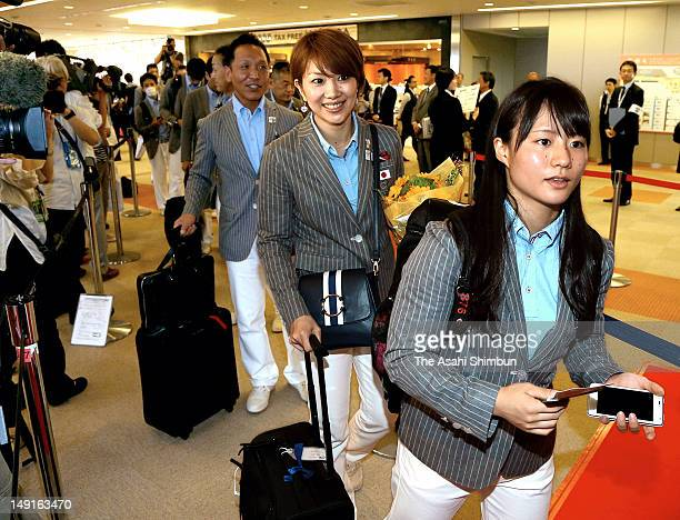 Kanae Yagi women's weightlifting and Reiko Shiota badmington mixed doubles player are seen upon departure at Narita International Airport on July 22...