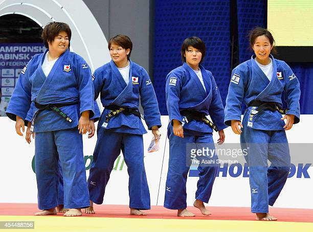Kanae Yamabe Miku Tashiro Ai Shishime and Yuki Hashimoto show smiles after winning the bronze in Women's Team during the 2014 Chelyabinsk Judo World...