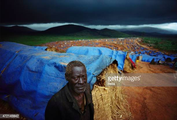 Kanague Camp Lake Cyohoha Rwanda During the Rwandan Genocide in a refugee camp a Burundian Hutu man wanders around the tents