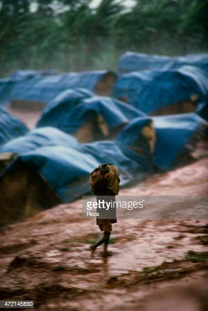 Kanague Camp Lake Cyohoha Rwanda During the Rwandan Genocide in a refugee camp an orphan Burundian Hutu boy runs under the rain in the middle of the...