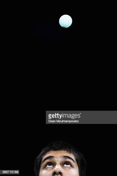 Kanak Jha of Team USA looks at the ball as he gets ready to serve at the Table Tennis practice session during the Olympics preview day 2 at Rio...