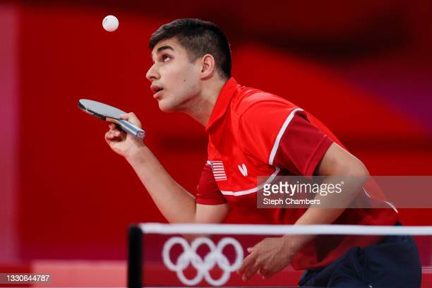 Kanak Jha of Team USA serves the ball during his Men's Singles Round 2 match on day three of the Tokyo 2020 Olympic Games at Tokyo Metropolitan...