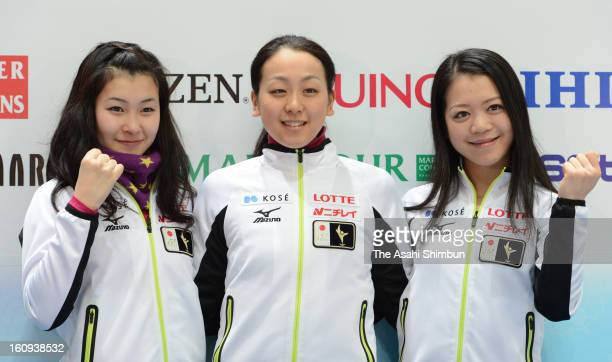 Kanako Murakami Mao Asada and Akiko Suzuki of Japan pose for photographs during a press conference ahead of the ISU Four Continents Figure Skating...