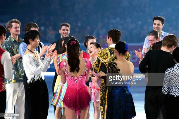 Kanako Murakami of Japan is applauded by skaters during her retirement ceremony at the gala exhibition during day four of the ISU World Team Trophy...
