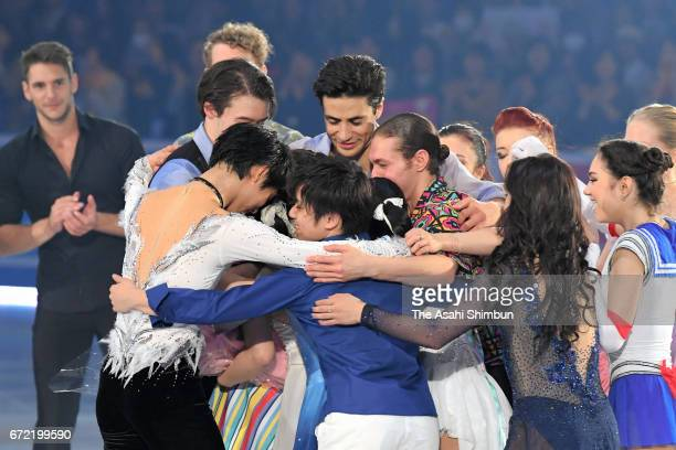 Kanako Murakami of Japan is embraced by skaters during her retirement ceremony at the gala exhibition during day four of the ISU World Team Trophy at...