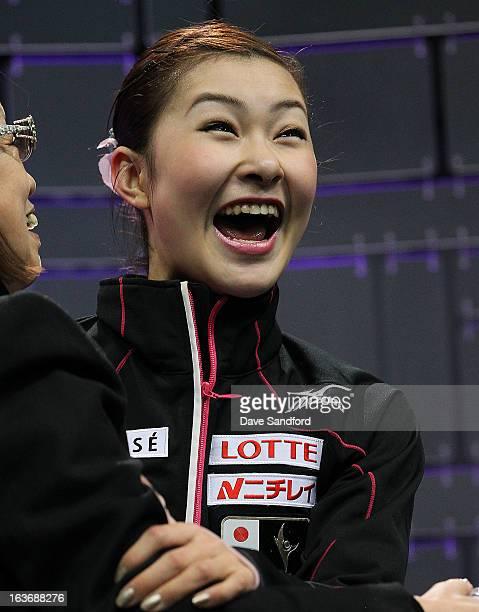 Kanako Murakami of Japan reacts to her score after skating in the Ladies Short Program during the 2013 ISU World Figure Skating Championships at...
