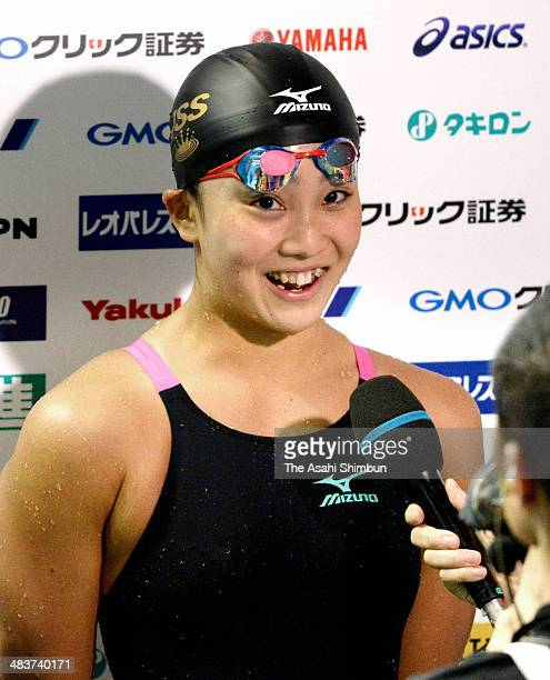 Kanako Watanabe is interviewed after winning in the Women's 100m Breaststroke during day one of the Japan Swim at Tokyo Tatsumi International...