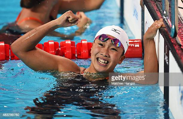Kanako Watanabe of Japan celebrates after winning the gold medal in the Women's 200m Breaststroke final on day fourteen of the 16th FINA World...