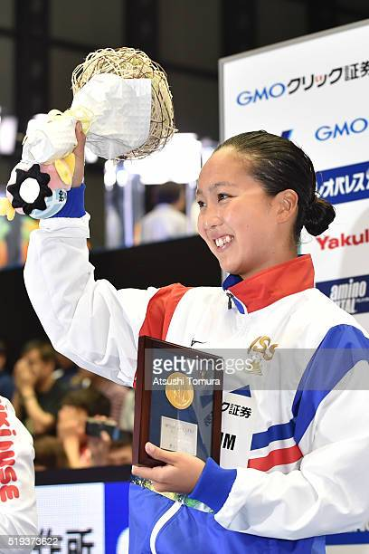 Kanako Watanabe of Japan celebrates on the podium after the Women's 100m Breaststroke final during the Japan Swim 2016 at Tokyo Tatsumi International...