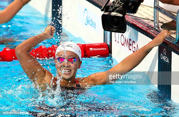 Kanako Watanabe of Japan celebrates winning the gold medal in the Women's 200m Breaststroke on day fourteen of the 16th FINA World Championships at...