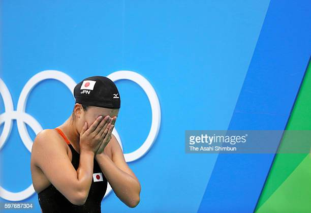 Kanako Watanabe of Japan reacts after competing in the Women's 200m Breaststroke seifinal on Day 5 of the Rio 2016 Olympic Games at the Olympic...