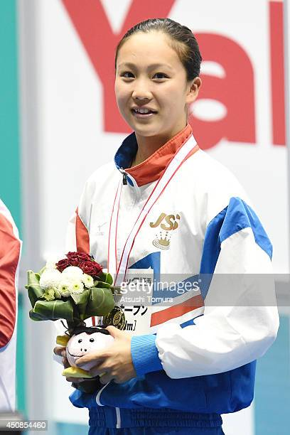 Kanako Watanabe of Japan smiles on the podium after winning the gold medal for women 100m Breaststroke and breaking the Japan record during day one...