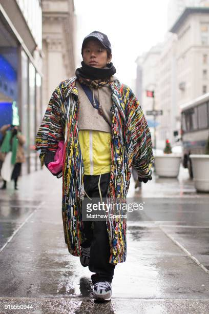 Kaname Murakami is seen on the street attending BOSS during New York Fashion Week Men's wearing a long multicolor coat on February 7 2018 in New York...
