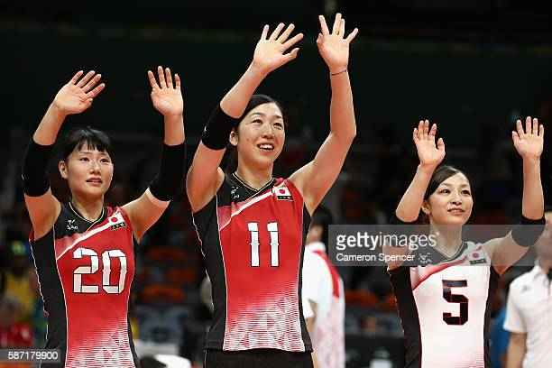 Kanami Tashiro Erika Araki and Arisa Sato of Japan thank the crowd after winning the Women's Preliminary Pool A match between Japan and Cameroon on...