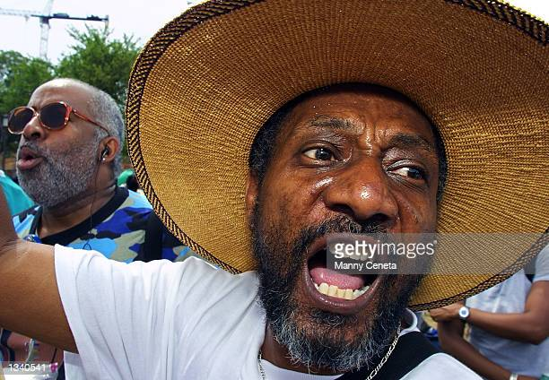 """Kanau Jywanza from Indianapolis, Indianapolis, shouts, """"reparations! black power"""" as he joins other demonstrators for slave reparations on the..."""