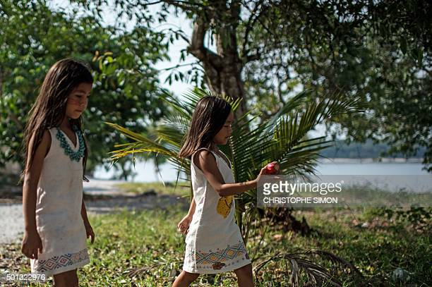 Kanbeba indigenous girls play in Tres Bocas village on the bank of the Rio Negro in the Amazonia Brazil on December 9 2015 AFP PHOTO / Christophe...