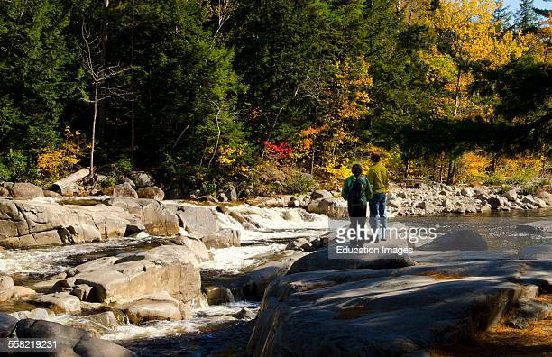 Kancamagus Highway New Hampshire near Conway Swift River Lower Falls with couple