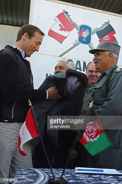 Canadian Foreign Affairs Minister Peter MacKay receives a gift from Kandahar police chief general Asmatullah Aliziai while Afghan Foreign Minister...