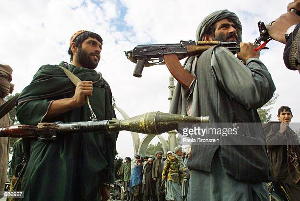 Kandahar Governor Gul Agha Shirzais men patrol the streets near his compound December 12 2001 in Kandahar Afghanistan Kandahar has been peaceful in...