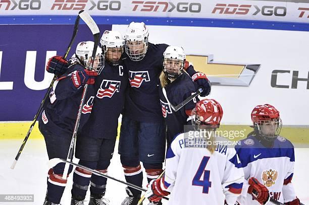 US Kandall Coyne Brianna Decker Hilary Knight and Emily Pfalzer celebrate Brianna Decker's 11 goal during the 2015 IIHF Ice Hockey Women's World...
