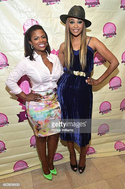 Kandi Burruss and Cynthia Bailey attend a royal tea seminar at The Biltmore on July 27 2014 in Atlanta Georgia