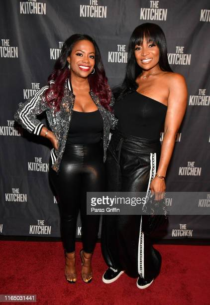 Kandi Burruss and Marlo Hampton attend The Kitchen Atlanta screening hosted by Kandi Burruss at Cinebistro on July 29 2019 in Atlanta Georgia