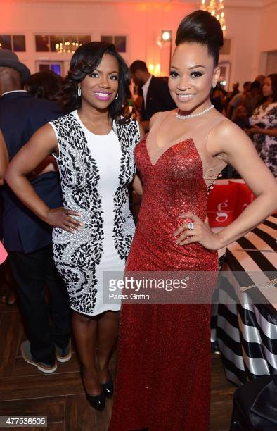 Kandi Burruss and Monyetta Shaw attend the 2014 Heels Of Greatness Dinner at The Estate at Pedimont on March 9 2014 in Atlanta Georgia