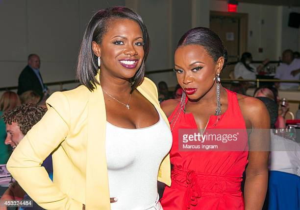 Kandi Burruss and Phaedra Parks attend G Garvin Live at Buckhead Theatre on August 7 2014 in Atlanta Georgia