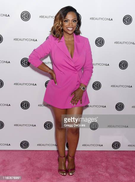 Kandi Burruss attends Beautycon Los Angeles 2019 Pink Carpet at Los Angeles Convention Center on August 10 2019 in Los Angeles California