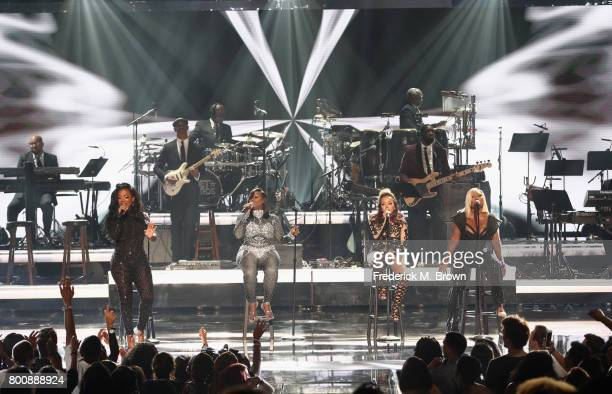 Kandi Burruss Tamika Scott Tameka Cottle and LaTocha Scott of Xscape perform onstage at 2017 BET Awards at Microsoft Theater on June 25 2017 in Los...