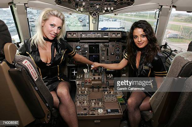 Kandi Girls pose in the cockpit as they unveil a Monarch Airlines Boeing 757 emblazoned with the Hed Kandi logo at Luton Airport on April 27 2007 in...