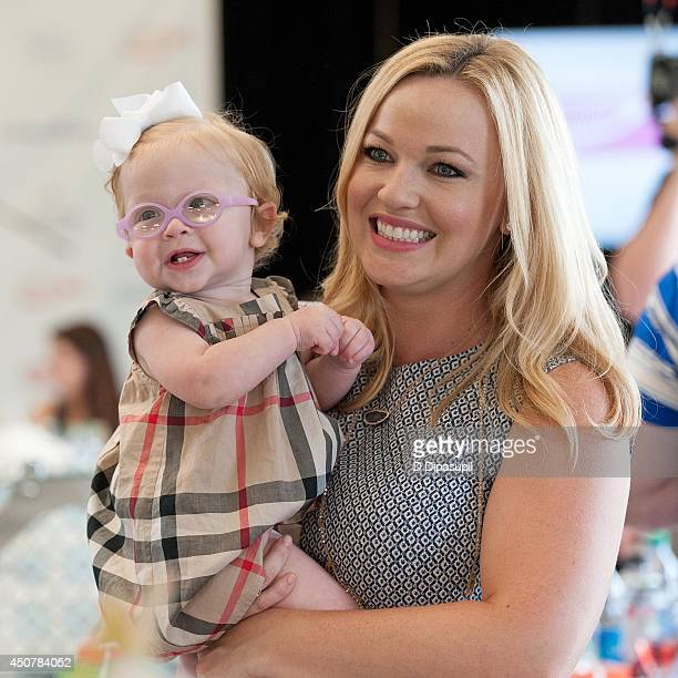 Kandi Mahan and daughter Zoe Mahan attend Operation Shower's Welcome Aboard Baby at TPC River Highlands on June 17 2014 in Cromwell Connecticut