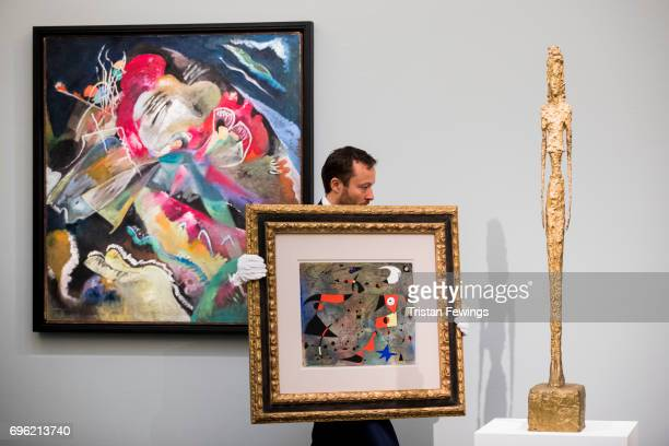 Kandinsky's Bild mit weissen Linien Miro's Femme et oiseaux and Giacometti's Bronze with gold patina go on view at Sotheby's on June 15 2017 in...