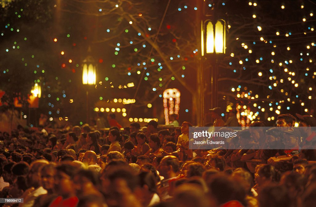 A packed crowd line the streets to watch the Esala Perahera parade. : Stock Photo