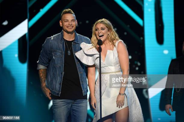 Kane Brown and Lauren Alaina accept an award at the 2018 CMT Music Awards at Bridgestone Arena on June 6 2018 in Nashville Tennessee