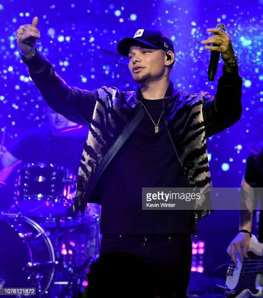 Kane Brown performs onstage during Dick Clark's New Year's Rockin' Eve With Ryan Seacrest 2019 on December 31 2018 in Los Angeles California