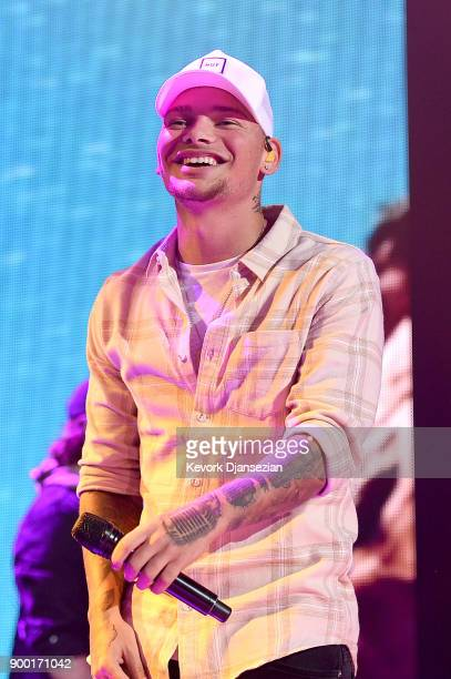 Kane Brown performs onstage during Dick Clark's New Year's Rockin' Eve with Ryan Seacrest 2018 on December 31 2017 in Los Angeles California