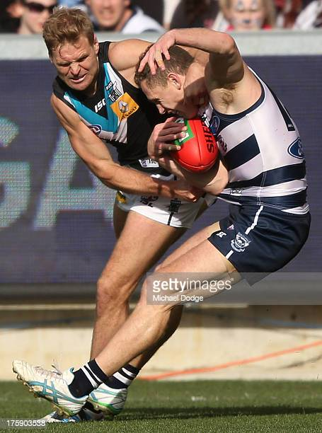 Kane Cornes of Port Adelaide tackles too high Joel Selwood of the Cats during the round 20 AFL match between the Geelong Cats and Port Adelaide at...