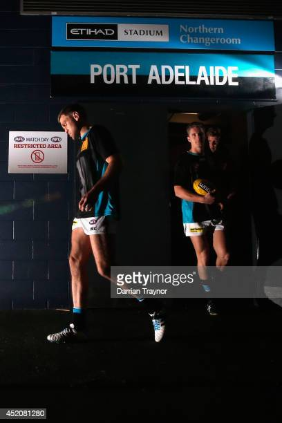 Kane Cornes of the Power leads the team out for the warm up before the round 17 AFL match between the Richmond Tigers and the Port Adelaide Power at...