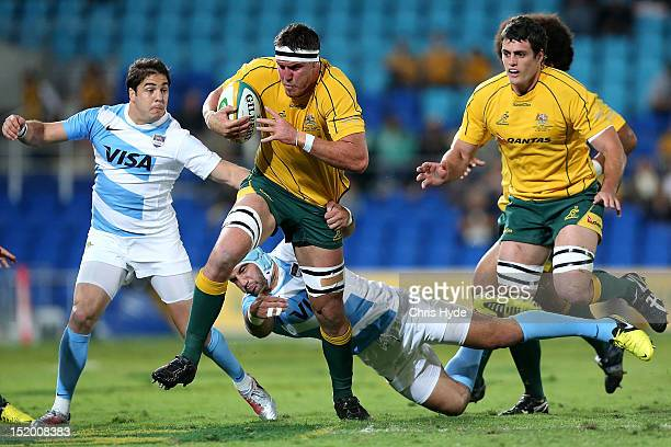 Kane Douglas of the Australian Wallabies is tackled during the Rugby Championship match between the Australian Wallabies and Argentina at Skilled...