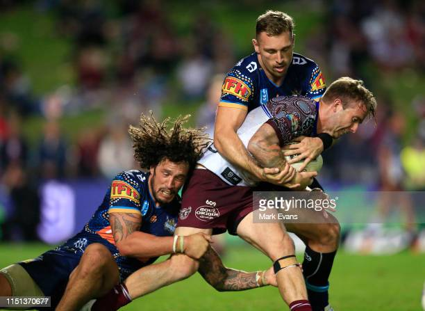 Kane Elgey of Manly is tackled during the round 11 NRL match between the Manly Sea Eagles and the Gold Coast Titans at Lottoland on May 24, 2019 in...
