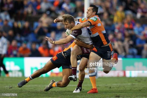 Kane Elgey of the Manly Sea Eagles is tackled by Mitchell Pearce of the Newcastle Knights during the round five NRL match between the Newcastle...
