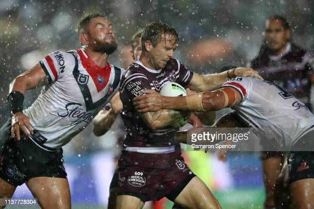 Kane Elgey of the Sea Eagles is tackled during the round two NRL match between the Manly Sea Eagles and the Sydney Roosters at Lottoland on March 23...