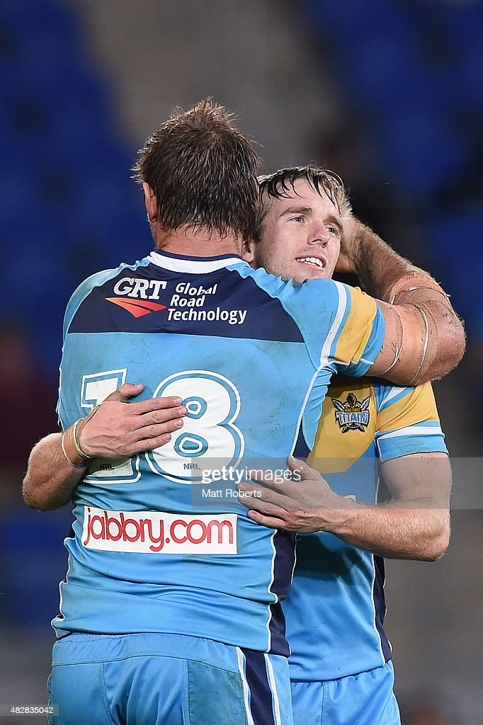 Kane Elgey of the Titans celebrates victory with Dave Taylor (L) during the round 21 NRL match between the Gold Coast Titans and the Parramatta Eels at Cbus Super Stadium on August 3, 2015 on the Gold Coast, Australia.