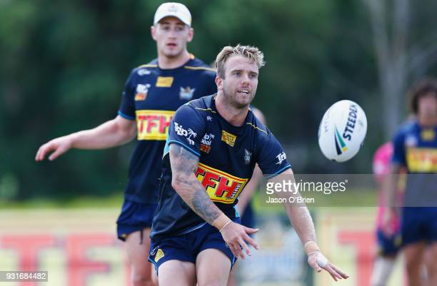 Kane Elgey passes the ball during a Gold Coast Titans NRL training session at Parkwood on March 14 2018 in Gold Coast Australia