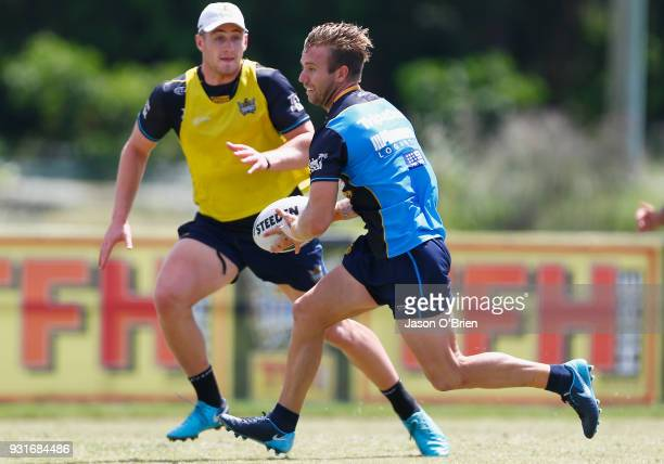 Kane Elgey runs the ball during a Gold Coast Titans NRL training session at Parkwood on March 14 2018 in Gold Coast Australia