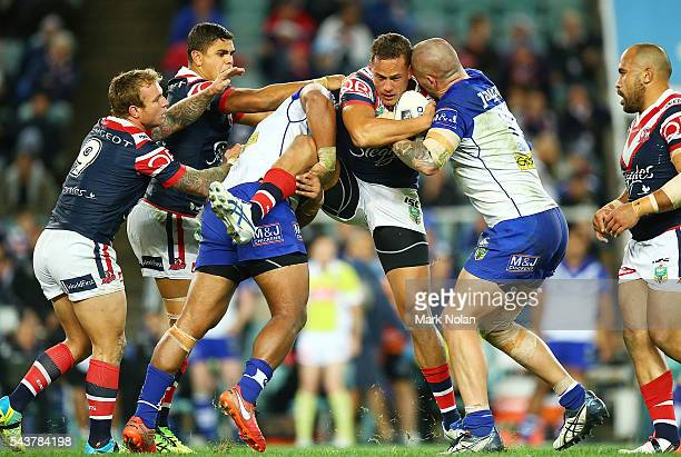 Kane Evans of the Roosters is tackled during the round 17 NRL match between the Sydney Roosters and the Canterbury Bulldogs at Allianz Stadium on...