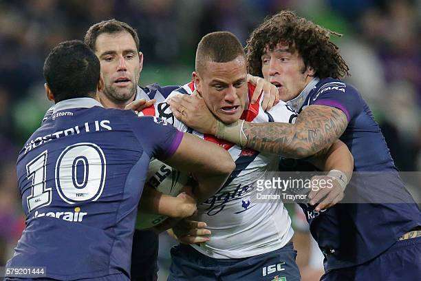 Kane Evans of the Roosters is tackled during the round 20 NRL match between the Melbourne Storm and the Sydney Roosters at AAMI Park on July 23 2016...